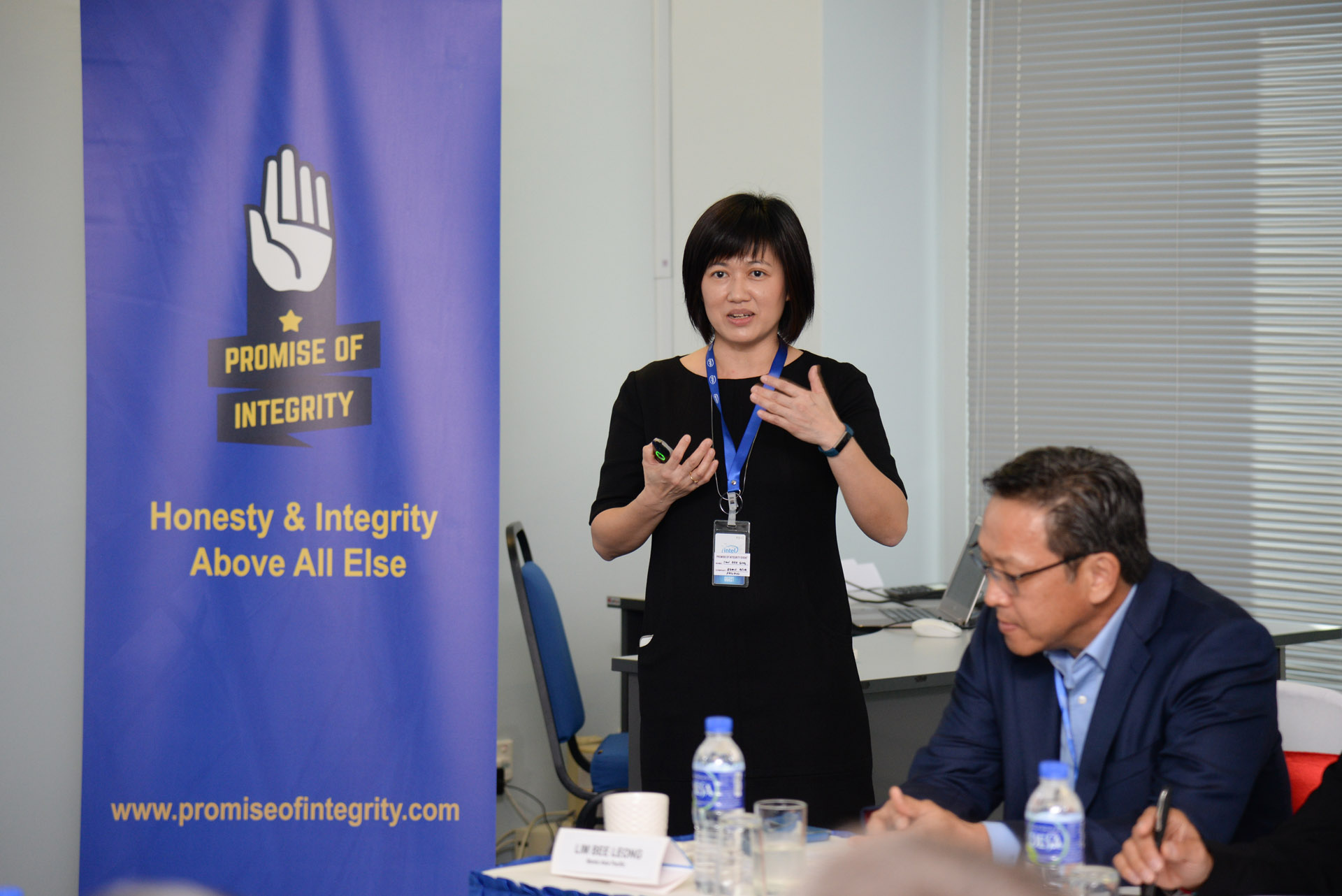 Ms Tan Bee Eng (Bemis Asia Pacific), co-lead of the Promise of Integrity Supplier Work Group giving a presentation during the Executive Dialogue